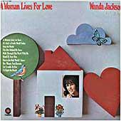 Cover image of A Woman Lives For Love